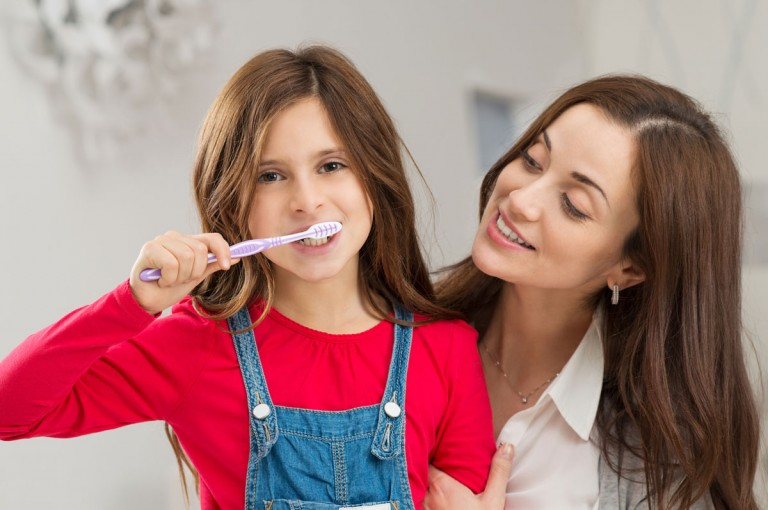 kid-brushing-with-mom